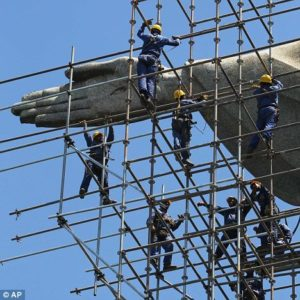 Group of men climbing on scaffolding